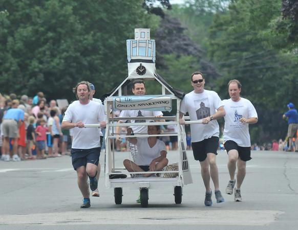 Newburyport: The Old South Church races to the finish line in the Yankee Homecoming Lions Club Bed Race on Federal Street Thursday night. Jim Vaiknoras/staff photo