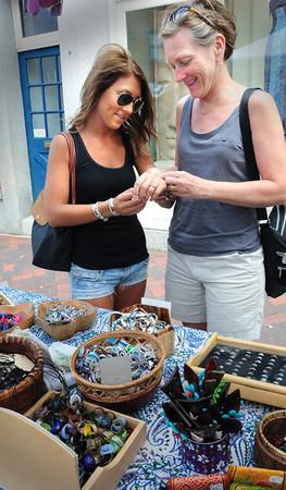 Newburyport: Laura Braun and her mother, Lynn Braun, of Newbury check out some bracelets at Ganesh Imports during Olde Fashion Sidewalk Sales. Bryan Eaton/Staff Photo