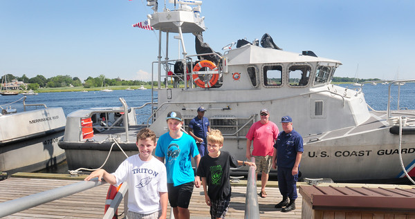 Newburyport: Checking out one of the two motor lifeboats was on the tour of the US Coast Guard Station Merrimack. Coming up the ramp after checking them out was, from left, Jack Crocker, 11, of Newbury and his brother, Cody, 13, and Kiefer Callewaert, 11, of Byfield. Bryan Eaton/Staff Photo