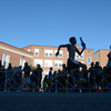 newburyport: Runner sprint by Newburyport High School as they finish the Yankee Homecoming 5k Tuesday night. Jim Vaiknoras/staff photo