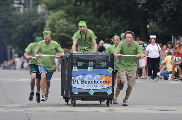 Newburyport: The Beachcoma participants, dressed as greenheads, run to the finish line in the Yankee Homecoming Lions Club Bed Race on Federal Street. Jim Vaiknoras/staff photo