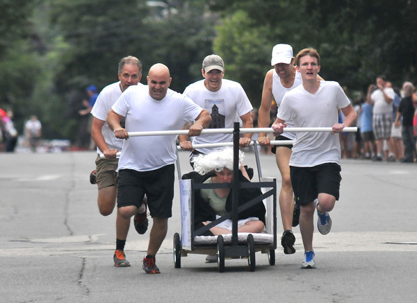Newburyport: The Old South Racers sprint to victory at the Yankee Homecoming Lions Club Bed Race on Federal Street Thursday night. Jim Vaiknoras/staff photo