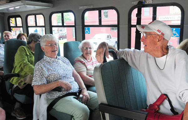 Newburyport: Ralph Ayers, right, readies to give a historical tour of Newburyport to residents of Nicols Village in Groveland. He quipped if they  weren't bored after an hour, he'd  do another hour. Bryan Eaton/Staff Photo