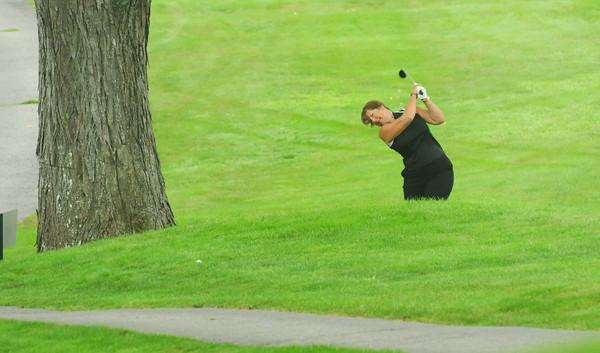 Newbury: Robin Prentise of Newburyport hits the golfball during the Yankee Homecoming Golf Tournament. Bryan Eaton/Staff Photo