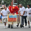 Newburyport: Samarra Painting and Elmo sprint to the finish line in the Yankee Homecoming Lions Club Bed Race on Federal Street. Jim Vaiknoras/staff photo