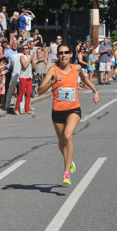 newburyport: High Street mile woman's winner Katie Matthews. Jim Vaiknoras/staff photo