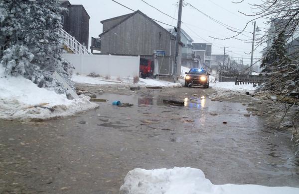 Newbury: Water floods Annapolis Way on Plum Island. Mac Cerullo/Staff Photo