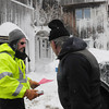 Newbury: Newbury conservation agent Doug Packer chats with homeowner Tom Nee before attaching a ceast and desist and an uninhabitable order on the building which was damaged further by the blizzard. Bryan Eaton/Staff Photo