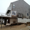 Newbury: This home on Annapolis Way on Plum Island was further undermined by the blizzard. Mac Cerullo/Staff Photo
