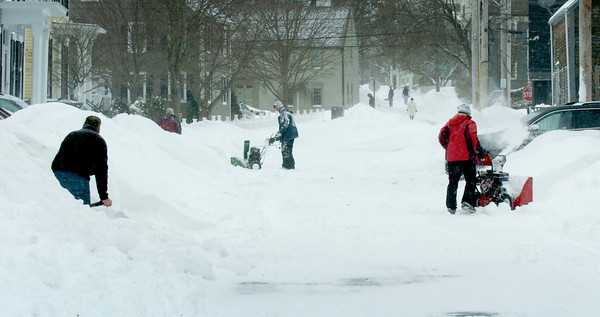 Newburyport: Residents of Fair Street in Newburyport were out with shovels and snowblowers late Saturday morning clearing the remains of the blizzard. Bryan Eaton/Staff Photo