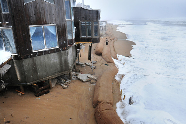 Newbury: The giant sandbags places at Annapolis Way held up, but waves were able to breach them causing further damage to homes there. Bryan Eaton/Staff Photo