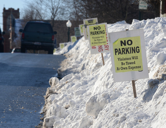 Amesbury: No parking signs stick out of high snow banks along Friend Street in Amesbury Sunday afternoon. Jim Vaiknoras/staff photo