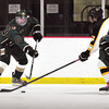Newburyport: Pentucket's Ian Mitchell grabs the puck and heads into Bishop Fenwick ice. Bryan Eaton/Staff Photo