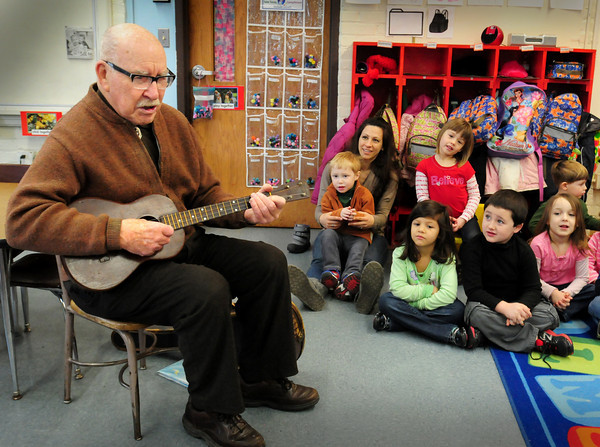 """Newburyport: Bill Plante, a former editor at the Daily News and now columnist, leads youngsters in """"Row, Row, Row Your Boat"""" with his ukelele at the Brown School on Tuesday. He was there for Read Across America and read """"I Love Boats"""" then played several songs. Bryan Eaton/Staff Photo"""