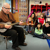 "Newburyport: Bill Plante, a former editor at the Daily News and now columnist, leads youngsters in ""Row, Row, Row Your Boat"" with his ukelele at the Brown School on Tuesday. He was there for Read Across America and read ""I Love Boats"" then played several songs. Bryan Eaton/Staff Photo"