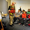 Amesbury: Todd McGrath, an engineer on the Bates Bridge project in Groveland, dressed in site visit garb, talks about the structure to sixth-graders at the Amesbury Middle School on Thursday. He was talking about the needs of present day structures that need to be able to withstand earthquakes which the children have been studying. Bryan Eaton/Staff Photo