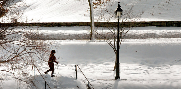 Newburyport: A cross country skier moves along at the Bartlet Mall in Newburyport on Monday afternoon. More snow is forecast overnight and predicted to change to rain later. Bryan Eaton/Staff Photo