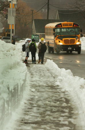 Newburyport: Students head home from the Nock Middle School yesterday afternoon. Newburyport was one of the few schools that opened in the region. Bryan Eaton/Staff Photo