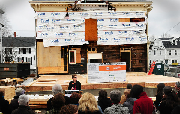 Newburyport: Judy Tymon, President of the YWCA board of directors speaks at a ceremonial groundbreaking of the construction of ten units of affordable housing, rear, next to the agencies Market Street location in Newburyport. Bryan Eaton/Staff Photo