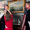 Newburyport: US Coast Guard Boston Sector Commander, Capt. John O'Connor, right, looks on as Ben Atwood is awarded the pin of his new rank of chief petty officer by his children, Jonathan, 11, left and Emily, 9, his wife, Jill, off camera, taking photographs. Atwood, who grew up in Newburyport and graduated from the high school, is stationed in Boston but wanted his pinning ceremony at the Custom House Maritime Museum because of his hometown's connection to the US Coast Guard. Bryan Eaton/Staff Photo