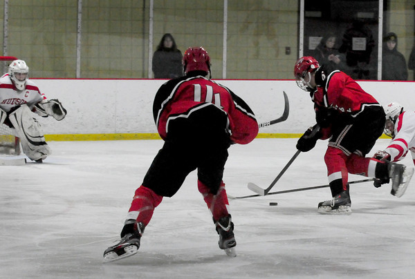 Newburyport: Amesbury's Tabor Smith moves the puck into Hudson territory but fell shot of a goal. Bryan Eaton/Staff Photo