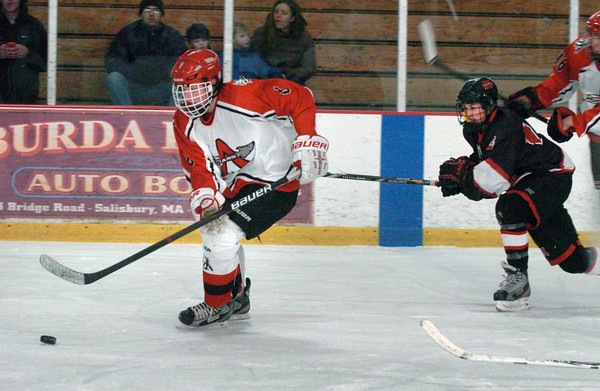 Newburyport: Amesbury's Andrew Reidy moves the puck into Marblehead ice yesterday afternoon. Bryan Eaton/Staff Photo