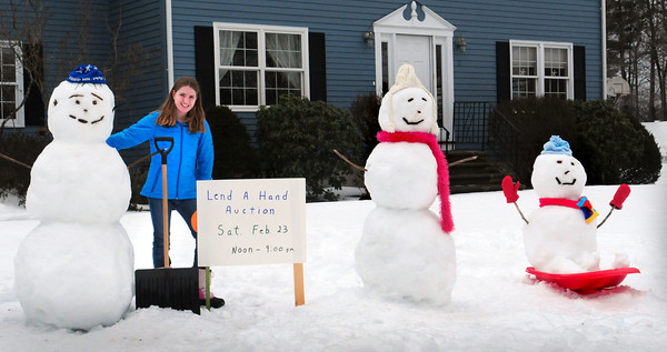 Newburyport: Alex Mackie, 13, created these snowmen at her Fox Run Drive, Newburyport home to bring attention to Opportunity Works' annual Lend-a-Hand Auction this weekend. She and other family members help out at the auction which raises money for the organizition to help citizens with disabilities. Bryan Eaton/Staff Photo