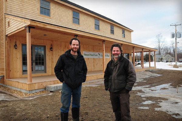 Kensington: Greg Belog, left, and Andre Cantelmo of Heron Pond Farm in South Hampton are opening an expanded farm stand in Kensington, just north of Seabrook, at Routes 107 and 150. They will still be running the South Hampton location. Bryan Eaton/Staff Photo