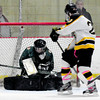 Newburyport: Pentucket goalie Sammantha Bomba makes a save on a shot by a Bishop Fenwick player at the Graf Rink last night. Bryan Eaton/Staff Photo