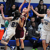 Newburyport: Newburyport's Aly Leahy aims for the net with pressure from Bedford players. Bryan Eaton/Staff Photo