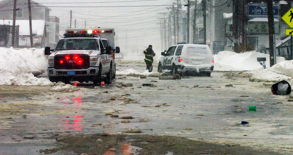 Salisbury: North End Boulevard at Salisbury Beach was closed to traffic as water rushed between homes carrying debris and flooding the roadway. Bryan Eaton/Staff Photo