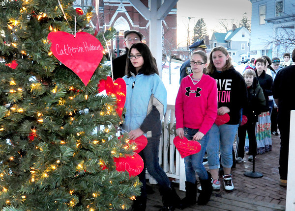 Amesbury: Amesbury Middle School students put Valentine hearts on a Christmas tree paying tribute to the 20 young students who were killed in a mass shooting in Newtown, Conn. two months ago today. Bryan Eaton/Staff Photo