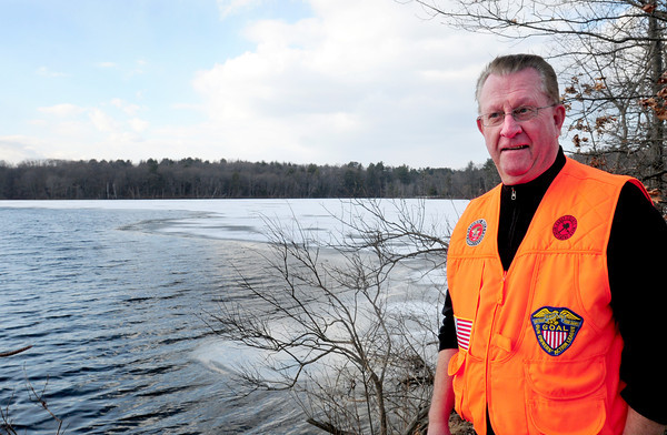 Newburyport: Gus Hoagland, president of the Essex County Sportmen's Association checks out the lack of ice at the Artichoke Reservoir. The group was hoping to have their 25th Annual Fishing Derby this weekend, but the warmer weather has changed their plans. Bryan Eaton/Staff Photo