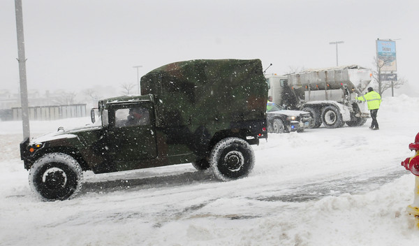Salisbury: One of several National Guard vehicles head to Salisbury Beach in case more residents had to be evacuated. Bryan Eaton/Staff Photo