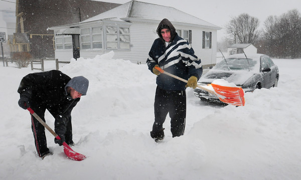 Salisbury: Matt McSharry, left, of Lynn was helping his uncle, Mike Abba, clear out his driveway at Salisbury Beach. Bryan Eaton/Staff Photo