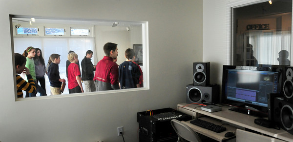 Newburyport: Nock Middle School students record their song in the sound studio at the Musical Suite. Bryan Eaton/Staff Photo