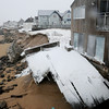 Newbury: This deck at 41 Annapolis Way on Plum Island was damaged. Bryan Eaton/Staff Photo