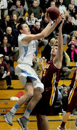Byfield: Triton's Sam Mckenzie tries for two points as Newburyport's Coltin Fontaine tries to block the shot. Bryan Eaton/Staff Photo