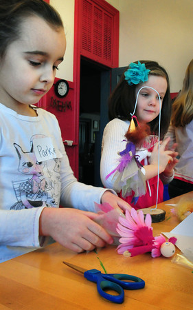 Newburyport: Several activities for Newburyport youngsters are on tap this week throught he city's Department of Youth Services. Here, Parker Harding, left, and Emerson O'Brien, both 6, create fairies under the direction of Elizabeth Rush. Bryan Eaton/Staff Photo
