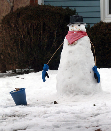 Salisbury: This snowman on Ferry Road in Salisbury looks a little worn down, and he may be worn down even more as rain was forecast Tuesday night. Bryan Eaton/Staff Photo