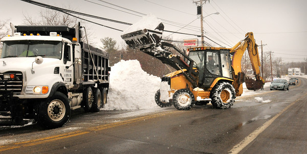 Salisbury: Area crews spent Monday clearing snow from the weekend storm that dumped two feet of snow in the area. The Salisbury DPW cleared the area around Salisbury Square, here on Lafayette Road. Bryan Eaton/Staff Photo