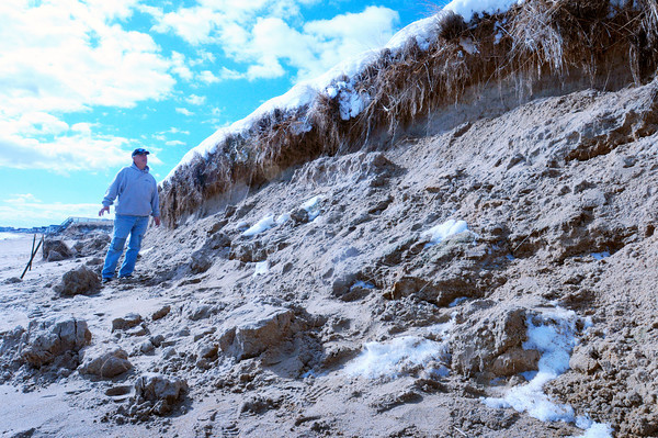 Salisbury: Seabrook resident Anthony Coletti, who walks along Salisbury Beach every morning, is concerned that erosion around public access number eight could pose a danger to children, who are on school vacation next week, by them falling off the edge or sand falling down on them. Bryan Eaton/Staff Photo