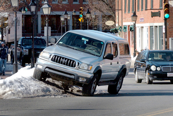 Newburyport: Parking can still be difficult in some places, here truck straddles a snowbank in Newburyport's Market Square. Somewhere around eight inches of snow is forecast for Sunday creating further headaches for snow removal crews and motorists. Bryan Eaton/Staff Photo