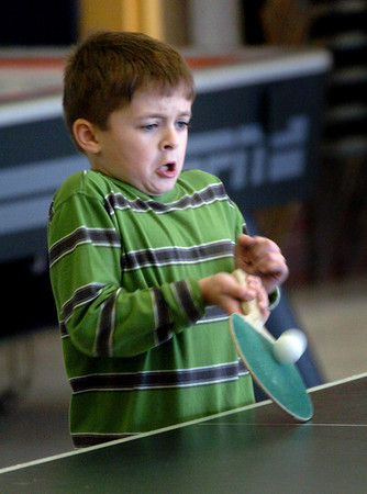 Salisbury: With a look of determination, Jonathan Zinck, 7, of Newburyport returns a shot to Abrielle Carrera, 11, in a game of ping pong. The two were at the Boys and Girls Club which is open days this week during school vacation. Bryan Eaton/Staff Photo