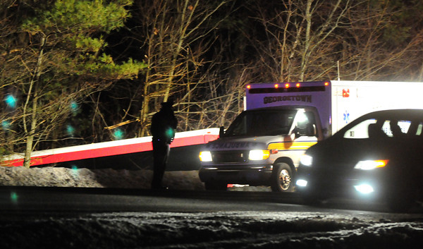 Georgetown: The top of a Cyr Bus Lines vehicle, carrying University of Maine girls basketball players, can be seen to left of photo, crashed into the side of Interstate 95 in Georgetown last night. Bryan Eaton/Staff Photo