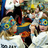 Newburyport: Caped education crusader Zero the Hero claps as he and students count to 100 in fives Tuesday morning. He was at the Brown School in Newburyport celebrating the 100th day of school. Bryan Eaton/Staff Photo
