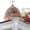 Rowley: Workers apply a protective layer of copper to the cupola on the Town Hall building in Rowley on Tuesday. The updates were made possible by funding from the town's Commmunity Preservation Committee, which was approved by voters at Town Meeting. Bryan Eaton/Staff Photo