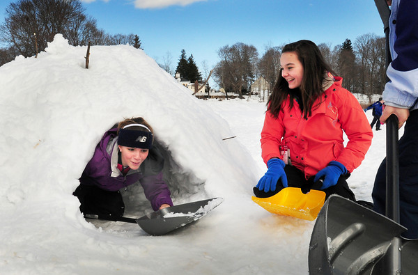 Newburyport: Krysta Padellaro, 12, emerges from a Quinzhee as Emma Filipancic, 13, looks on. Seventh-graders at the Nock Middle School in Newburyport took advantage of all the snow to build these snow shelters while learning about the properties of water in the making of them. Bryan Eaton/Staff Photo