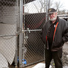 Salisbury: Salisbury animal control officer Harold Congdon shows off his kennel where dogs are kept in warm weather, keeping them in his barn in winter as needed. The part of the kennel shown is for dogs to get fresh air, they can go inside this shed to keep out of the elements. A news broadcast inferred canines in his care were kept in junk cars and other items stored on his property at right, across a wide driveway from the kennels. Bryan Eaton/Staff Photo