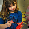 Salisbury: Mackenzie Claytt, 7, of Newburyport paints her hand red in the art room at the Boys and Girls Club in Salisbury. Children were putting different colors on construction paper as they were making Valentine Vases. Bryan Eaton/Staff Photo